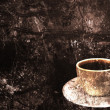 Coffee cup on a grunge background — Stock Photo