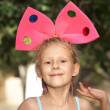 Stock Photo: The girl with bow