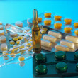 Ampoules and tablets - Stock Photo