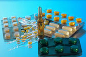 Ampoules and tablets — Stock Photo