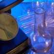 Microscope and test-tubes — Stock Photo
