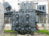 Huge industrial high-voltage substation power transformer — Stock Photo