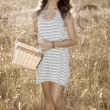 Girl in Hayfield - Stock Photo