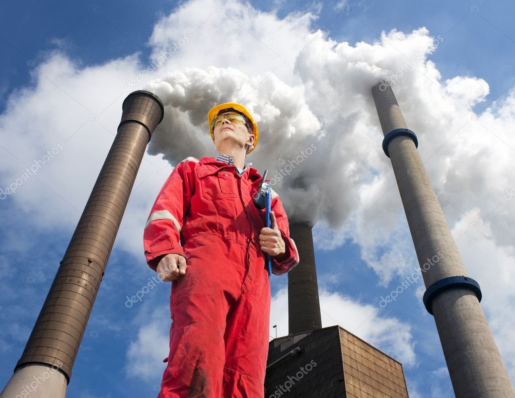 Engineer looking up towards the wind direction with tall smoke stacks, emitting vaporized water, seen from below — Stock Photo #10917577