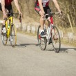 Stock Photo: Male Athletes Riding Bicycles