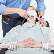 Man Being Shaved With Cut Throat Razor - Stock Photo