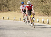 Cyclists Riding On A Country Road — Stock Photo