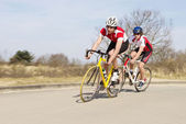 Cyclists Riding Cycles On Open Road — Stock Photo
