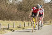 Cyclists Riding On Country Road — Stock Photo