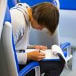Stock Photo: Filling out itinerary in train
