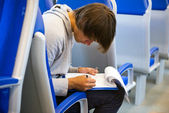 Filling out an itinerary in a train — Stock Photo