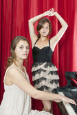 Two pretty girls performing on stage — Stock Photo