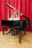 Duet on a single piano — Stock Photo