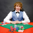 Smiling poker dealer — Stock Photo