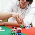 Full tilt poker hráč — Stock fotografie