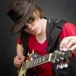 Royalty-Free Stock Photo: Tuning a guitar