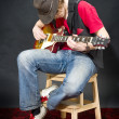 Sitting Guitar player — Stock fotografie