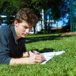 Homework in the park — Stock Photo