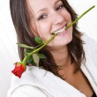 Woman biting rose — Stock Photo #11868361