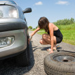 Changing a tire - Foto de Stock