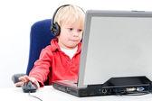 Boy behind a laptop — Stock Photo