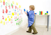 Boy ready to fingerpaint — Stock Photo