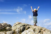 Boy reaching top — Stock Photo