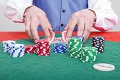 Smiling poker dealer — Stock Photo