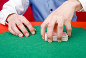 Grabbing a deck of cards — Stock Photo
