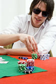 Full tilt poker player — Stock Photo