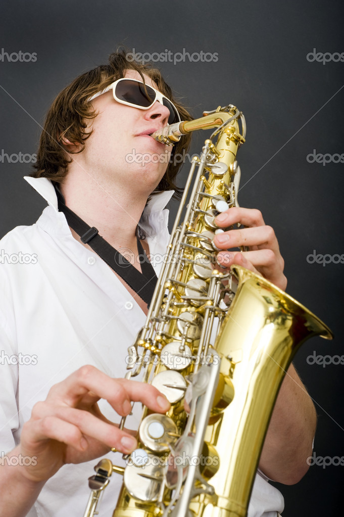 A man in a white shirt and open collar passionately playing the saxophone — Stock Photo #11866132