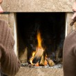 By the fireplace - Stockfoto