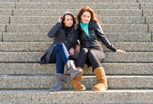 Women on steps — Stock Photo