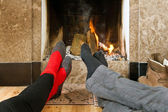 Warming by the fire — Stock Photo