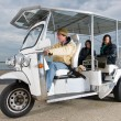 Solar powered tuc tuc at the beach — Stock Photo #11890331