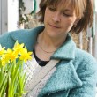 Buying Daffodils - Stock Photo