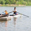 Handicapped rowing race - Stock Photo