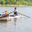 Stock Photo: Handicapped rowing race