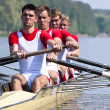 Stock Photo: Rowers during start