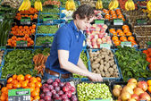 Greengrocer at work — Stock Photo