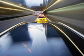 Speeding taxi — Stock Photo
