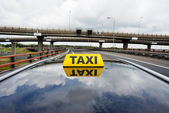 Taxi on flyover — Stock Photo