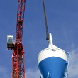 High rise Crane and Concrete mixer - Stock Photo