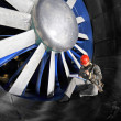 Windtunnel mainenance worker - Stock Photo