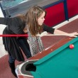 Woman playing pool — Stock Photo