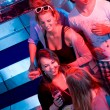 Stockfoto: Party in a nightclub viewed from the DJ booth