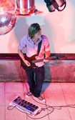 Guitarist on stage — Stock Photo
