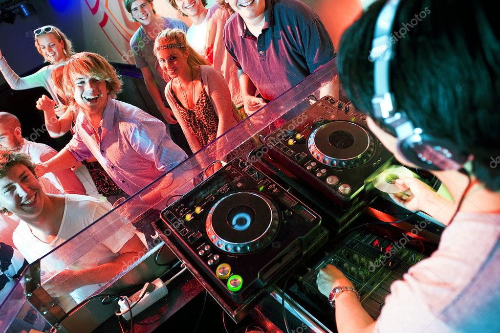 Group of dancing in front of a dj in a discotheque — Foto de Stock   #11983861
