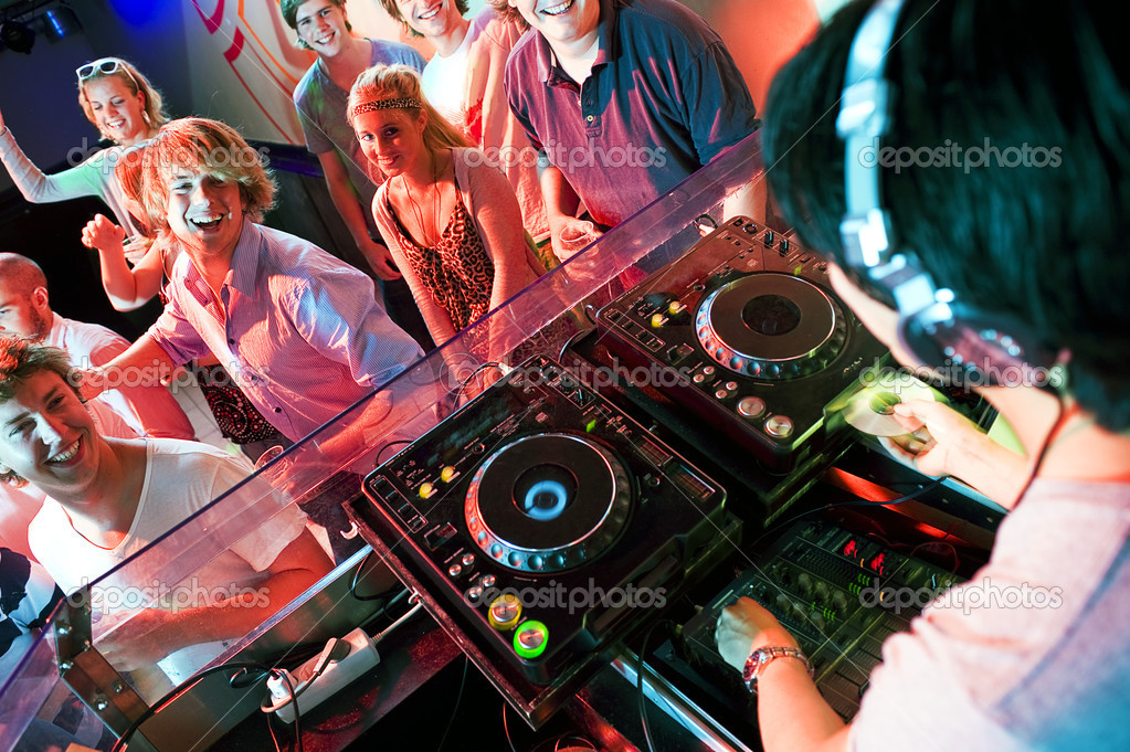 Group of dancing in front of a dj in a discotheque — Foto Stock #11983861