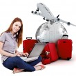 Beautiful young woman online trip planning with 3d luggage in the background — Stock Photo